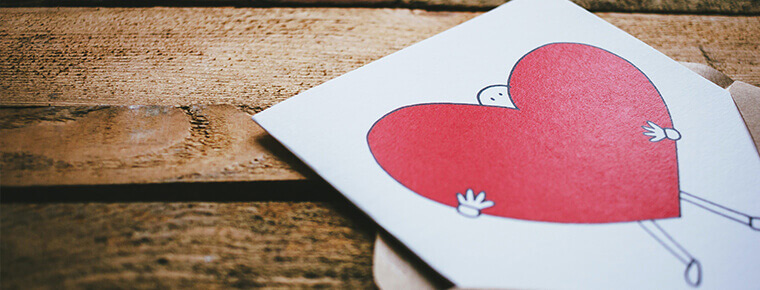 Greeting card of a cartoon person and a heart