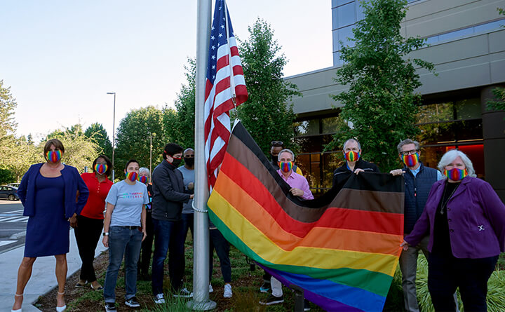 Pride flag in front of a building